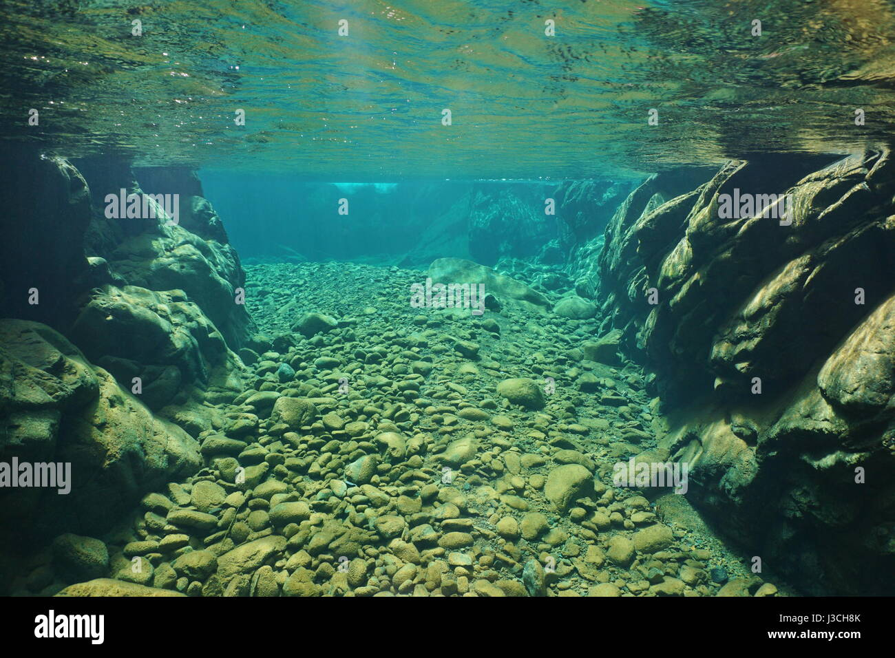 Rocks and pebbles underwater in a river with clear freshwater, Dumbea, New Caledonia, south Pacific Stock Photo