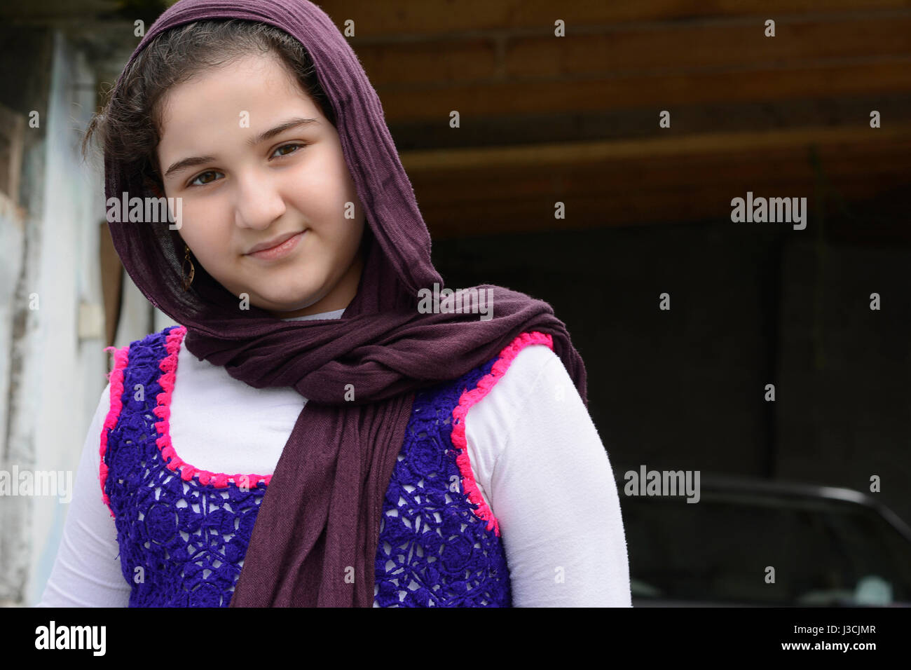 Portrait of Teenage Beautiful Girl Wearing Traditional Knitted Cloth with Shawl - Stock Image