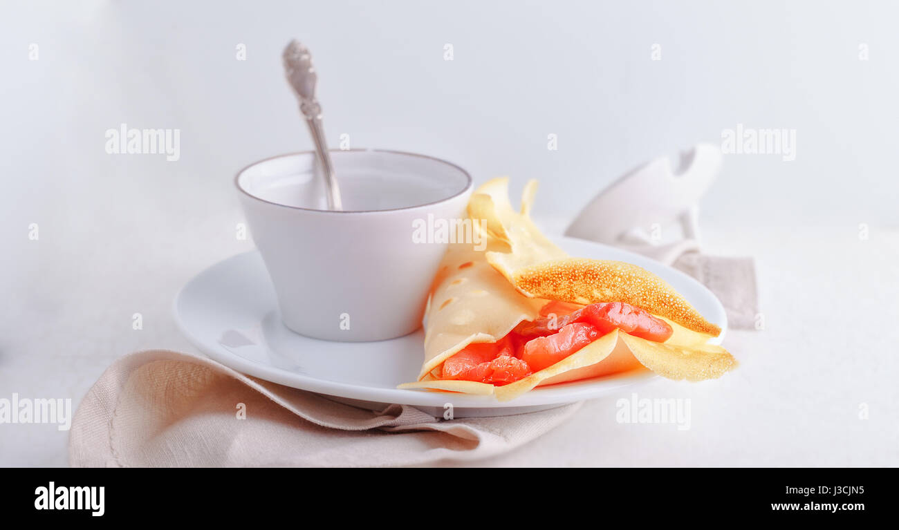 Crepe with smoked salmon. - Stock Image