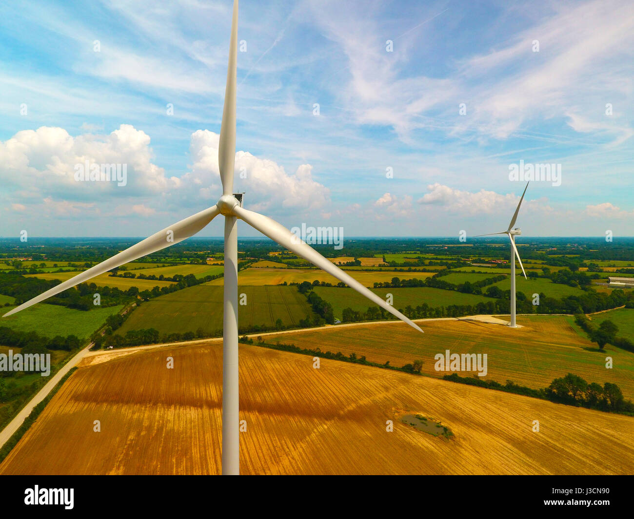 Drone photography of wind turbines in a field, near Sainte Pazanne, France - Stock Image