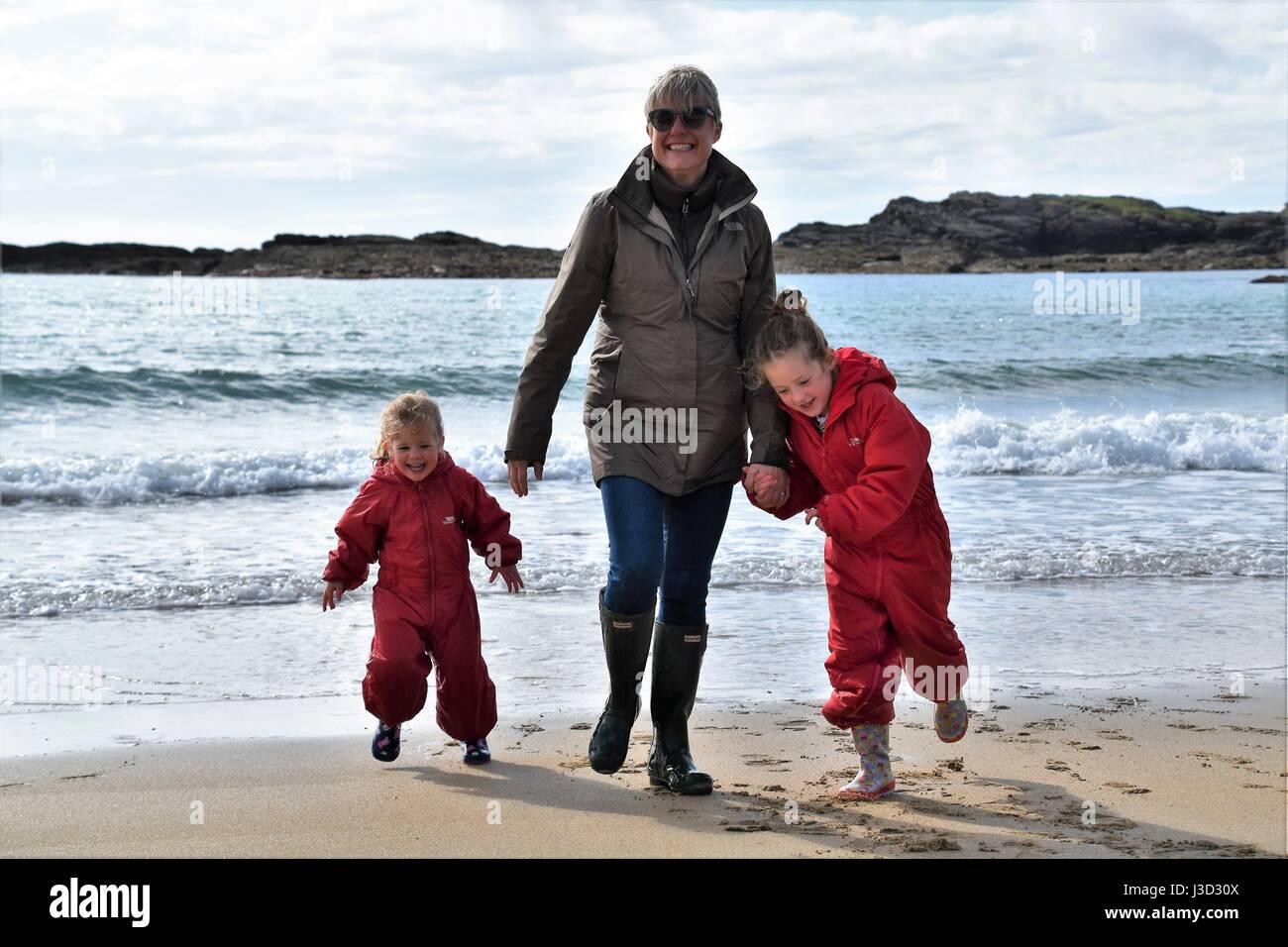 Family fun on Trearddur Bay, Anglesy, Wales - Stock Image