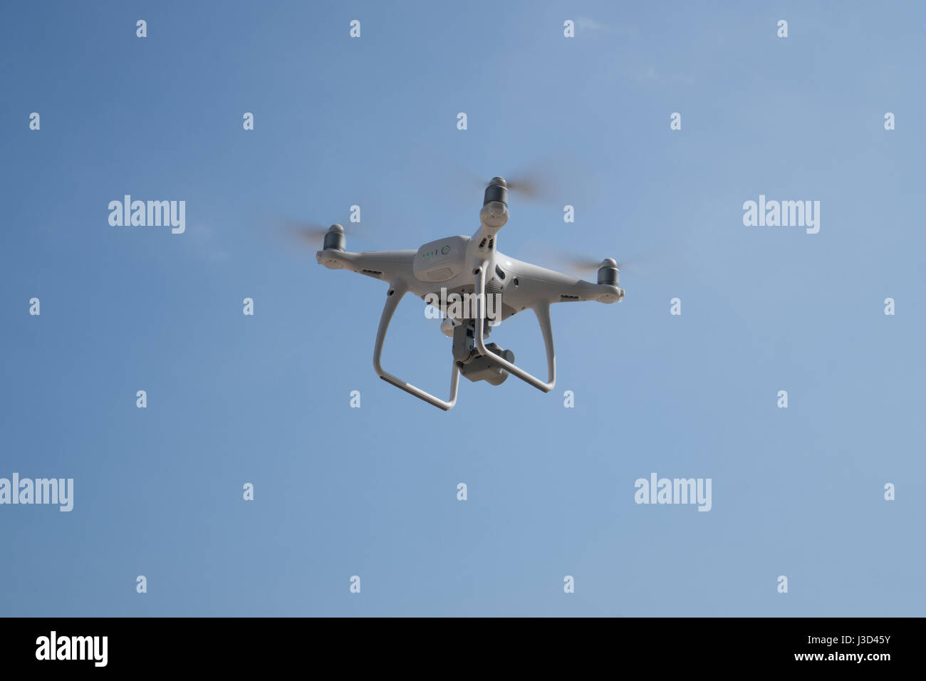 Flying drone with blue sky background controlled by