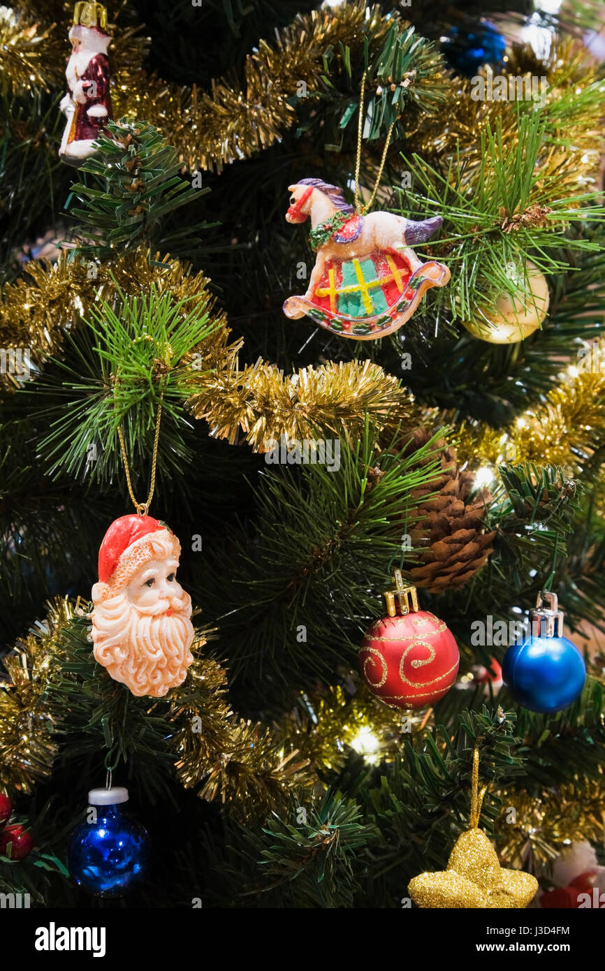 Close-up of an artificial Christmas tree with ornaments Stock Photo