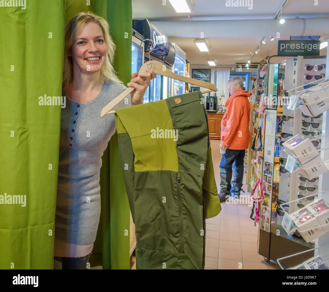Woman shopping for ski pants - Stock Image