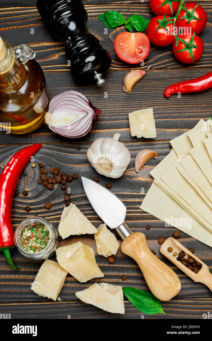 uncooked lasagna pasta sheets and ingridients - Stock Image