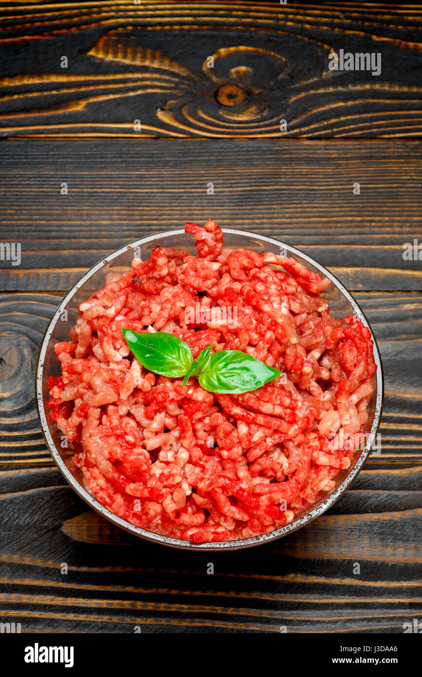 Minced meat of stuffing in glass bowl - Stock Image