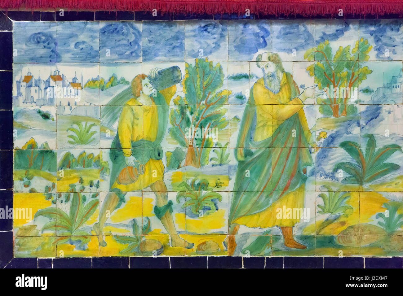 Sacrifice of Isaac depicted in the traditional Spanish tin-glazed painted tiles called Azulejos in the Chapel of - Stock Image