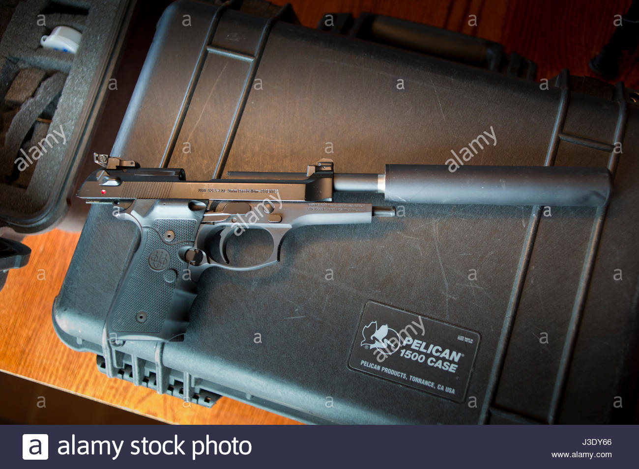 Beretta Model 92FS 9mm Parabellum Pistol With Sound Suppressor Attached To Barrel Laying On Hard Case USA