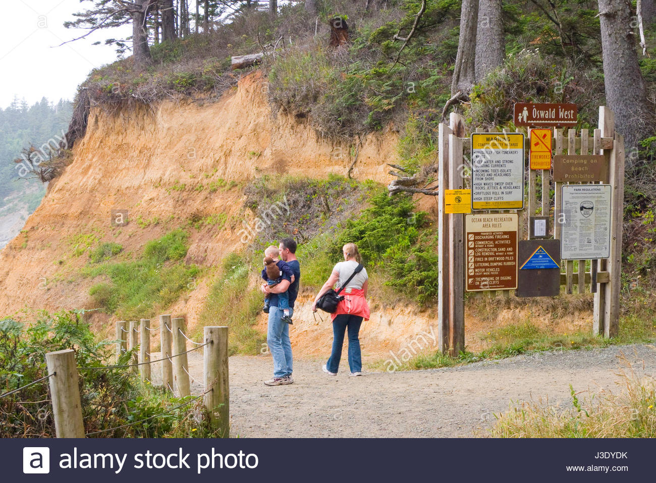Man carrying small child at Short Sands Beach, Oswald West State Park, Tillamook County, Oregon, USA - Stock Image