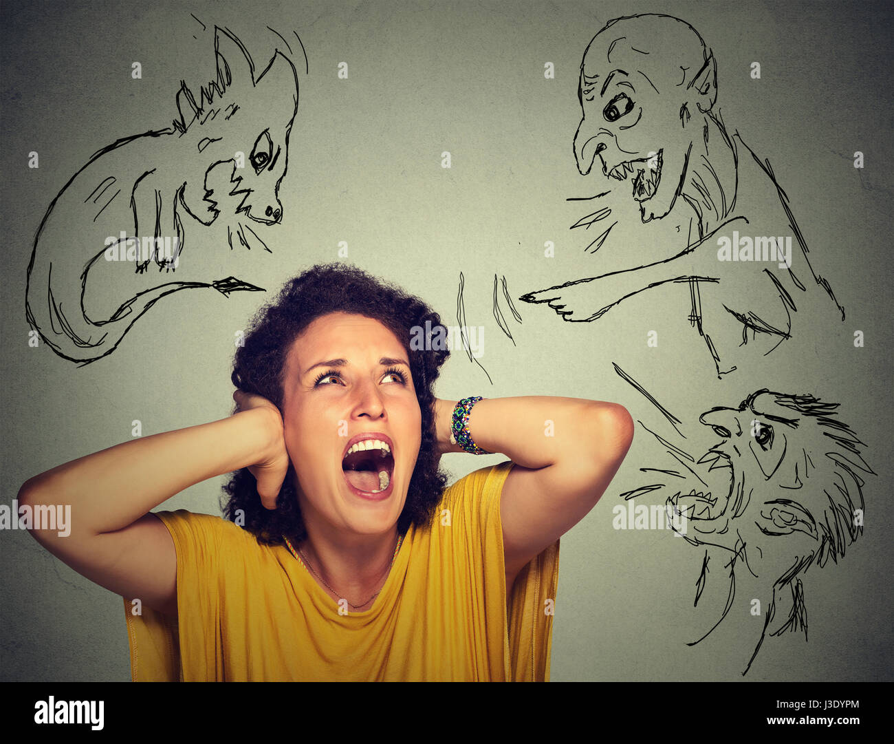 Bad evil men pointing at stressed woman. Desperate scared young woman isolated on grey office wall background. Negative - Stock Image