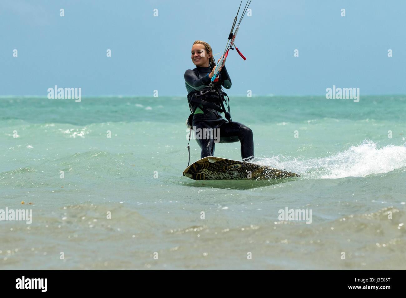 Young girl kitesurfing at Coco Plum Beach, Marathon Key, Florida, USA - Stock Image