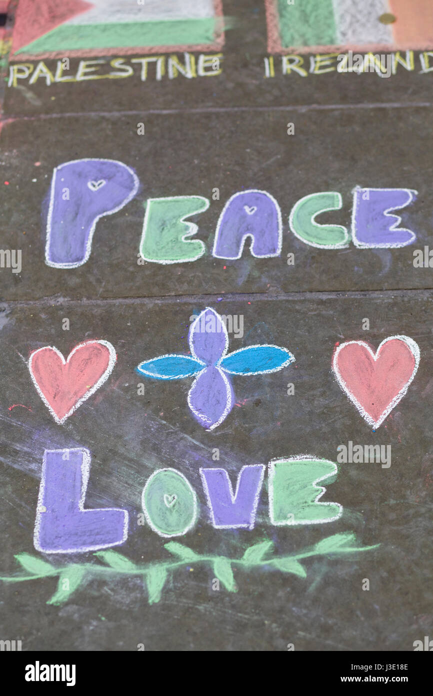 chalk drawing peace and love on a pavement - Stock Image