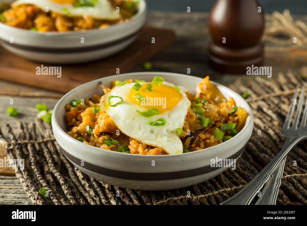 Homemade Korean Kimchi Fried Rice with an Egg - Stock Image