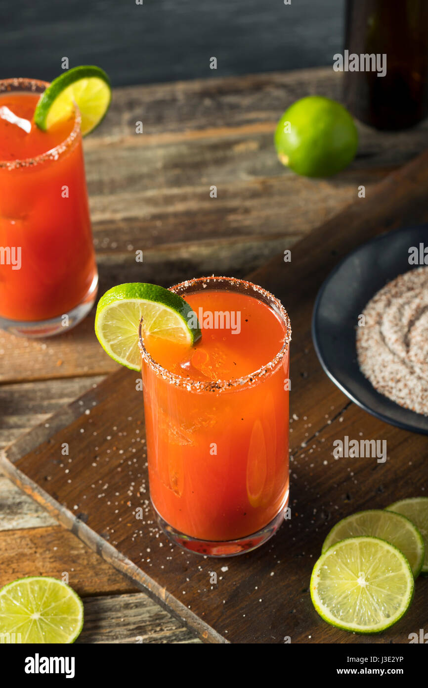 Homemade Michelada with Beer Salted Rim and Tomato Juice - Stock Image