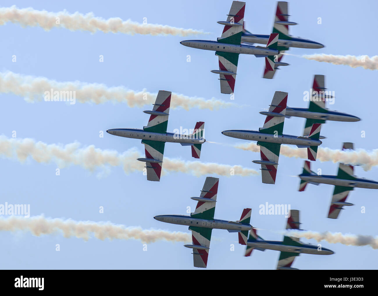The Italian Air Force Frecce Tricolori aerial demonstration team aircraft fly in formation over the Aviano Air Base - Stock Image