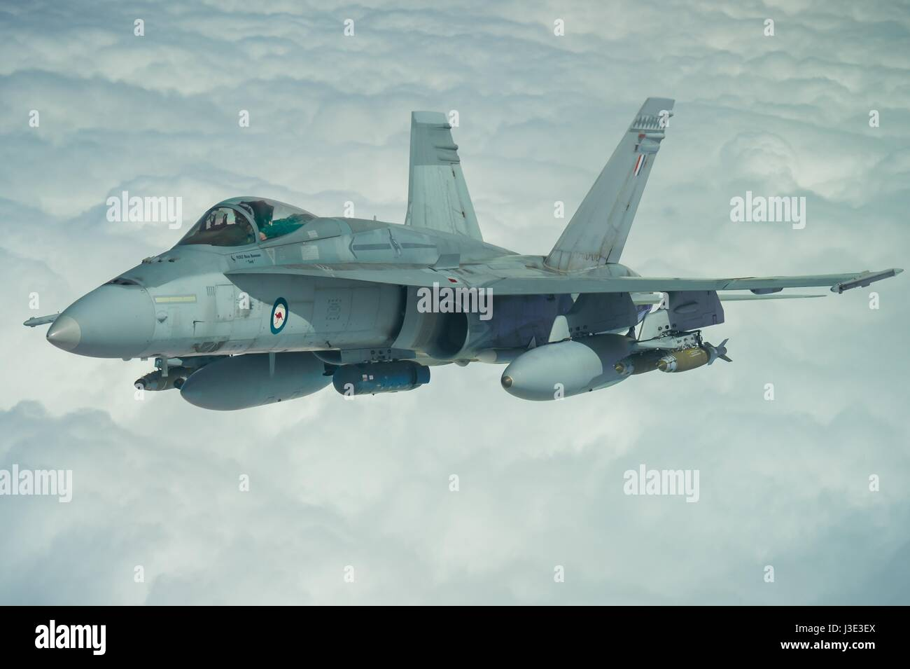 A Royal Australian Air Force F-18A Hornet fighter combat jet aircraft in fight during an Operation Okra mission Stock Photo