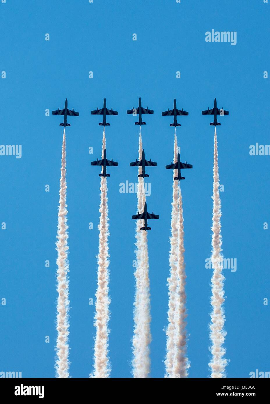 The Italian Air Force Frecce Tricolori aerial demonstration team aircraft practice flying formations over the Aviano - Stock Image