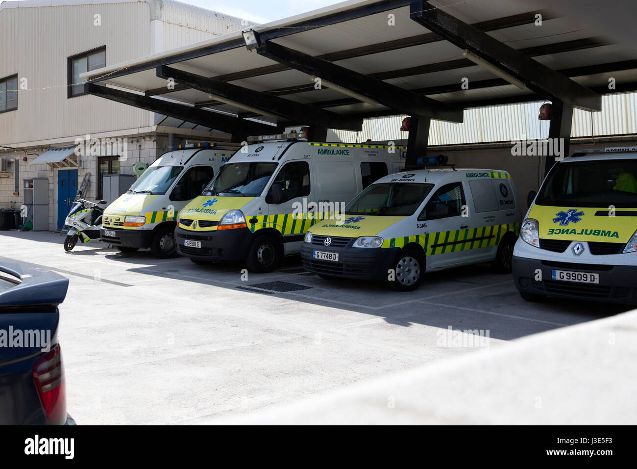 Emergency response vehicles parked at depot in Gibraltar - Stock Image