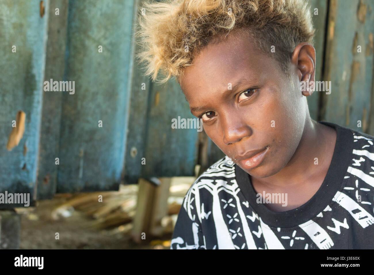 Santa Ana, Solomon Islands - March 6th, 2017: A melanesian boy portrait, looking at camera, Santa Ana, Solomon  - Stock Image