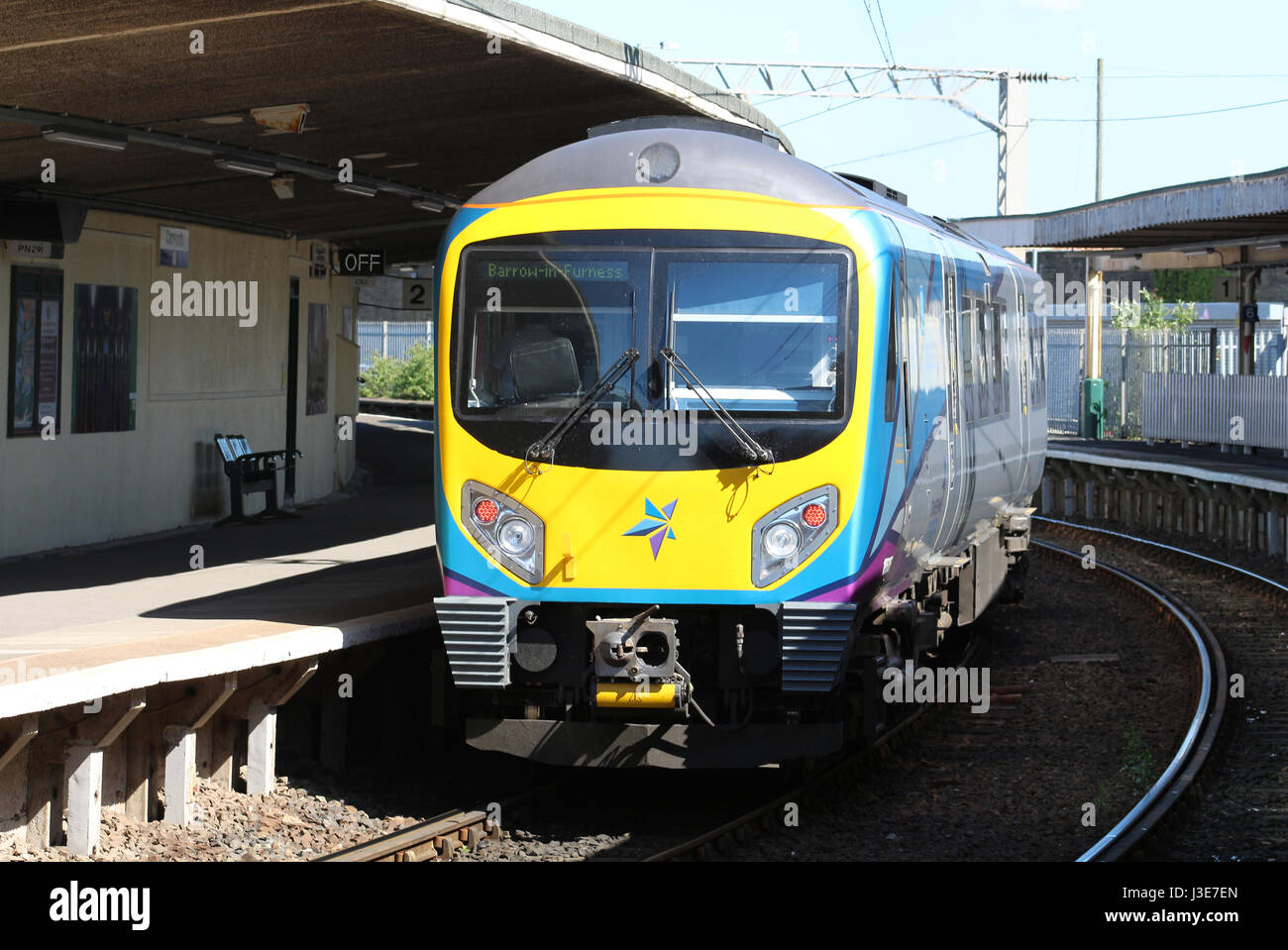 Class 185 Desiro diesel multiple unit in the new First TransPennine livery at Carnforth railway station with a service - Stock Image