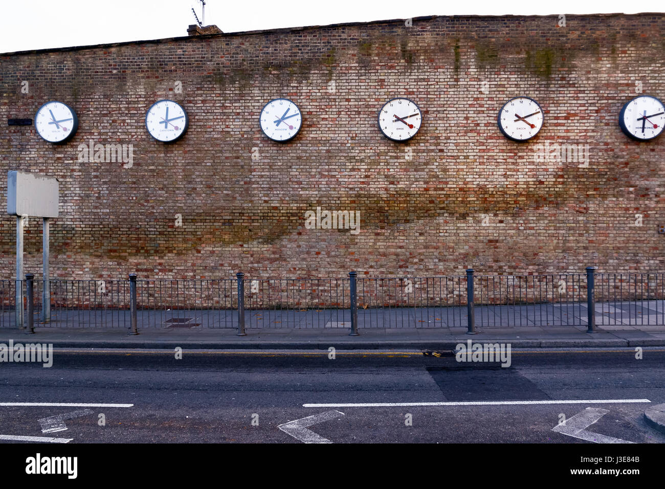 A series of clocks registering the times in major cities on Westferry Road, London - Stock Image