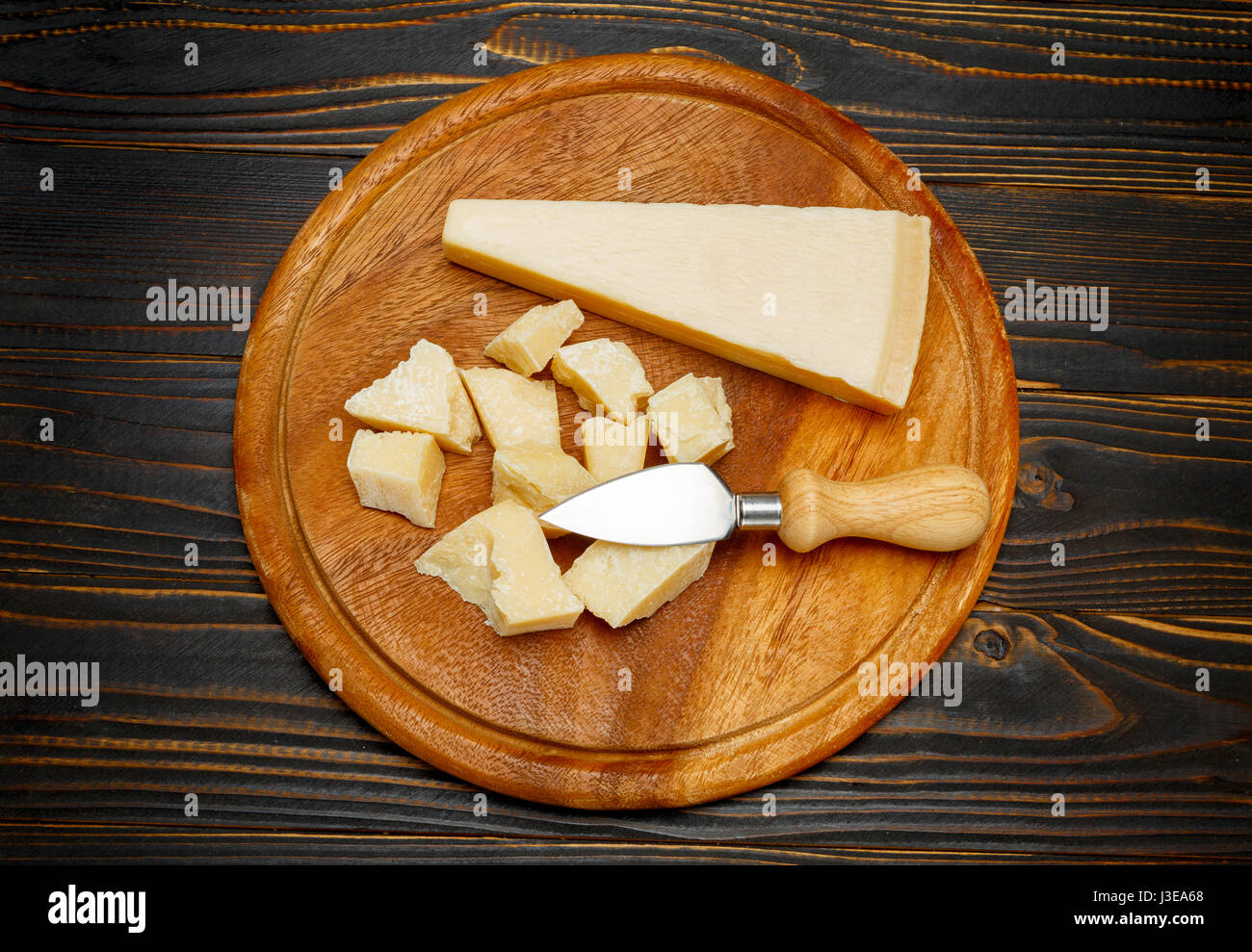 parmesan cheese on wooden background - Stock Image
