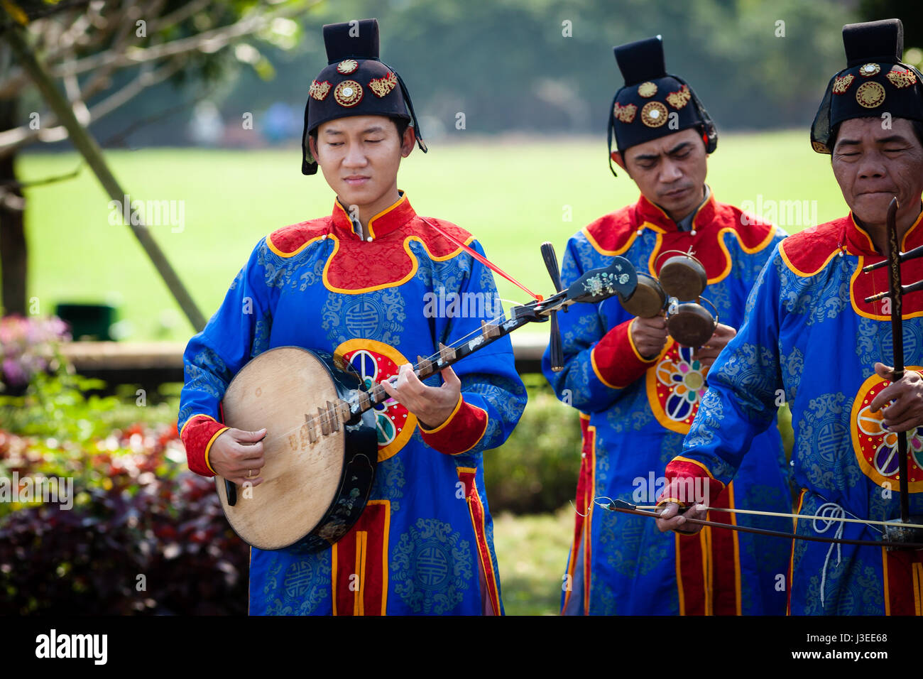 Hoi An, Vietnam - march 10 2017: vietnamese traditional music band is giving concert in Imperial Citadel. Musician - Stock Image