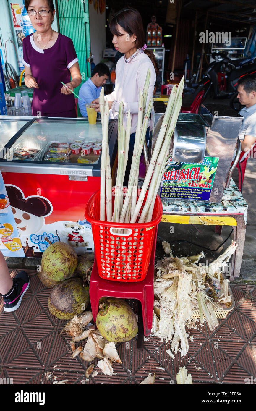 Hoi An, Vietnam - march 10 2017: production of cane juice. This popular refreshing drink can be bought on almost Stock Photo