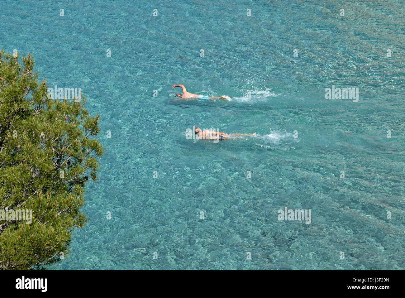 swimmers near Sant Elm, Mallorca, Spain - Stock Image