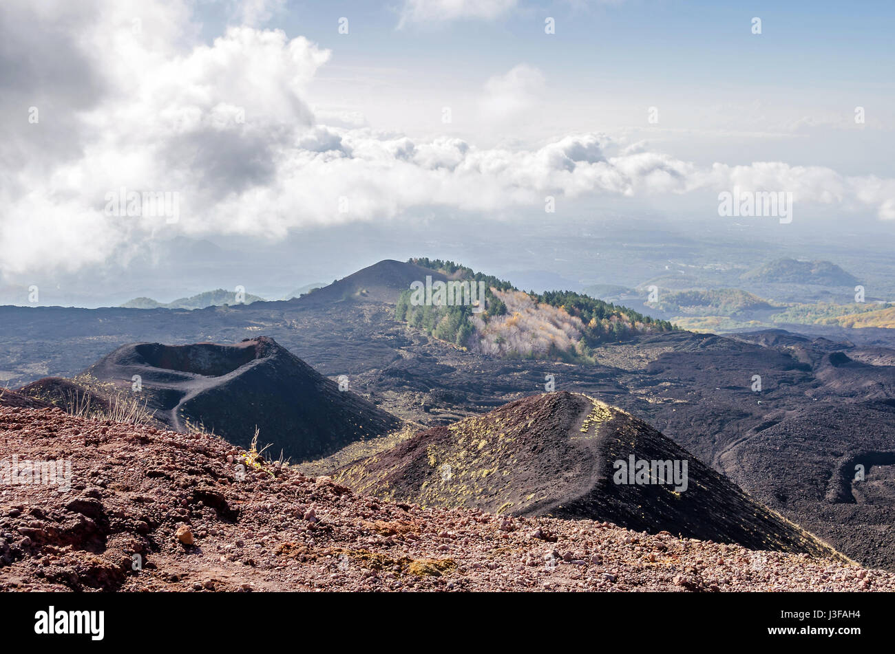Slope of Mount Etna, an active stratovolcano on the east coast of Sicily, Italy, below summit showing lateral cones, - Stock Image