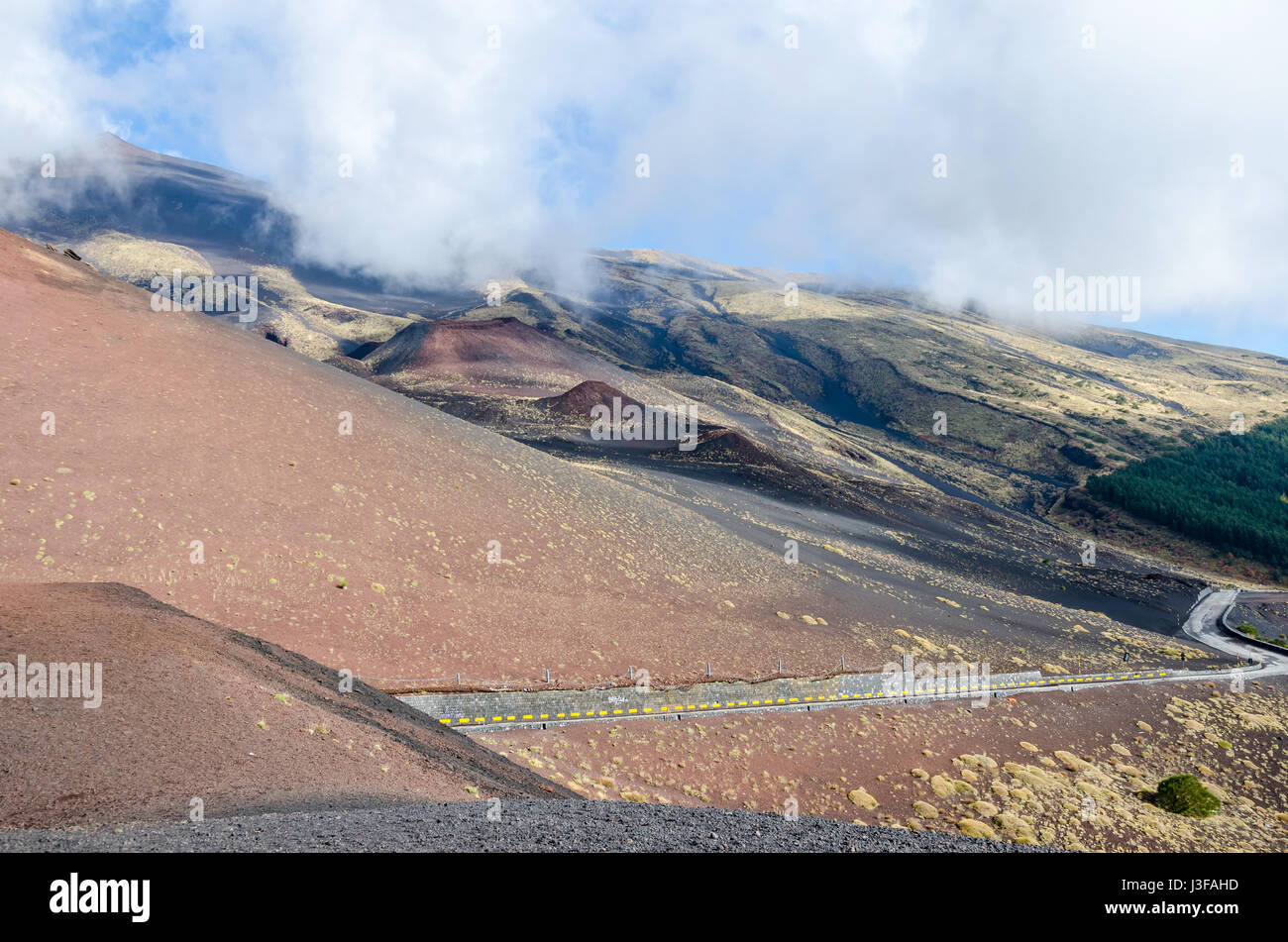 Southern flank of Mount Etna, an active stratovolcano on the east coast of Sicily, Italy, showing lateral crater - Stock Image