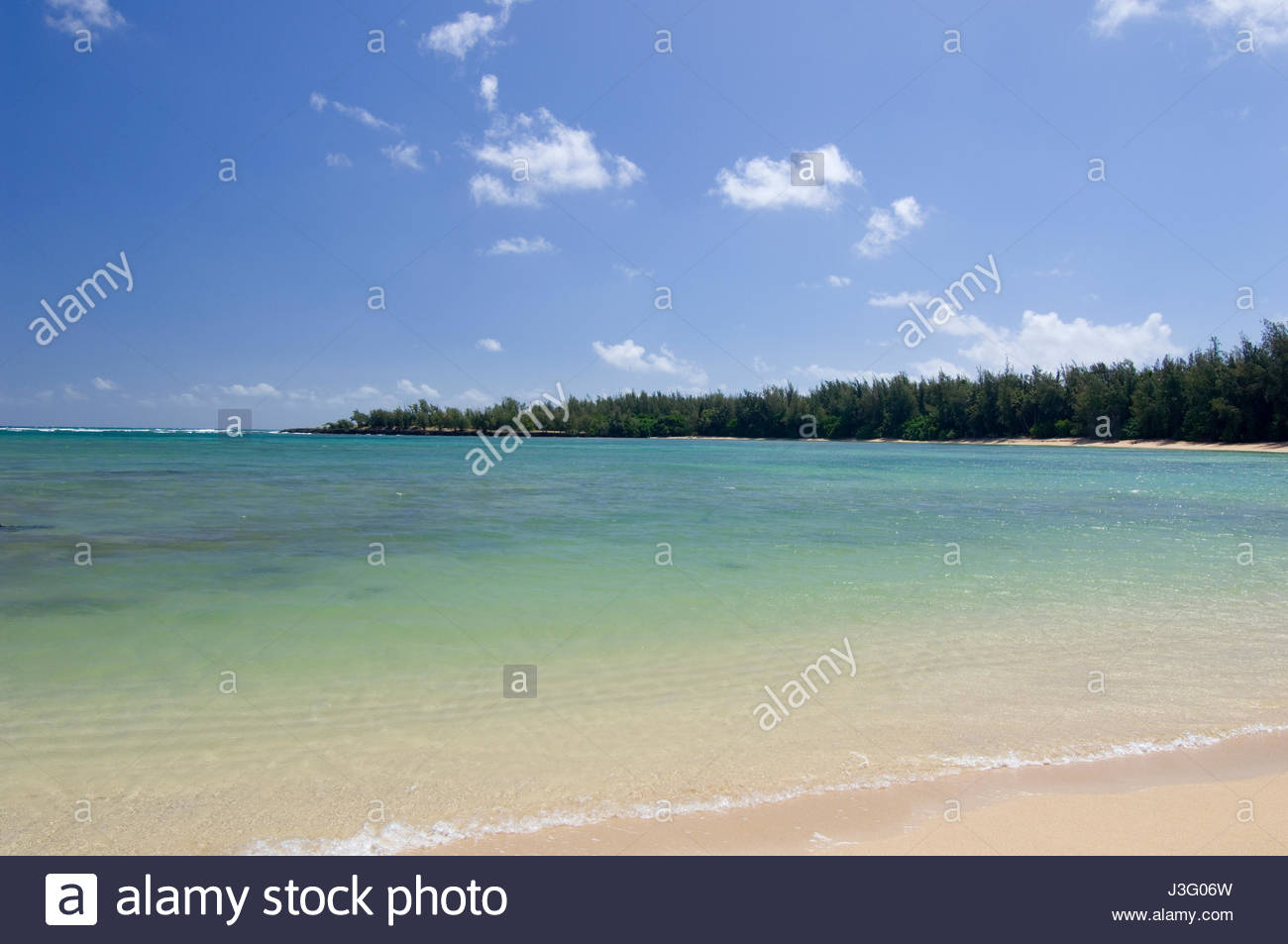 Clear blue-green of Kawela Bay, Kahuku, Oahu, Hawaii, USA - Stock Image
