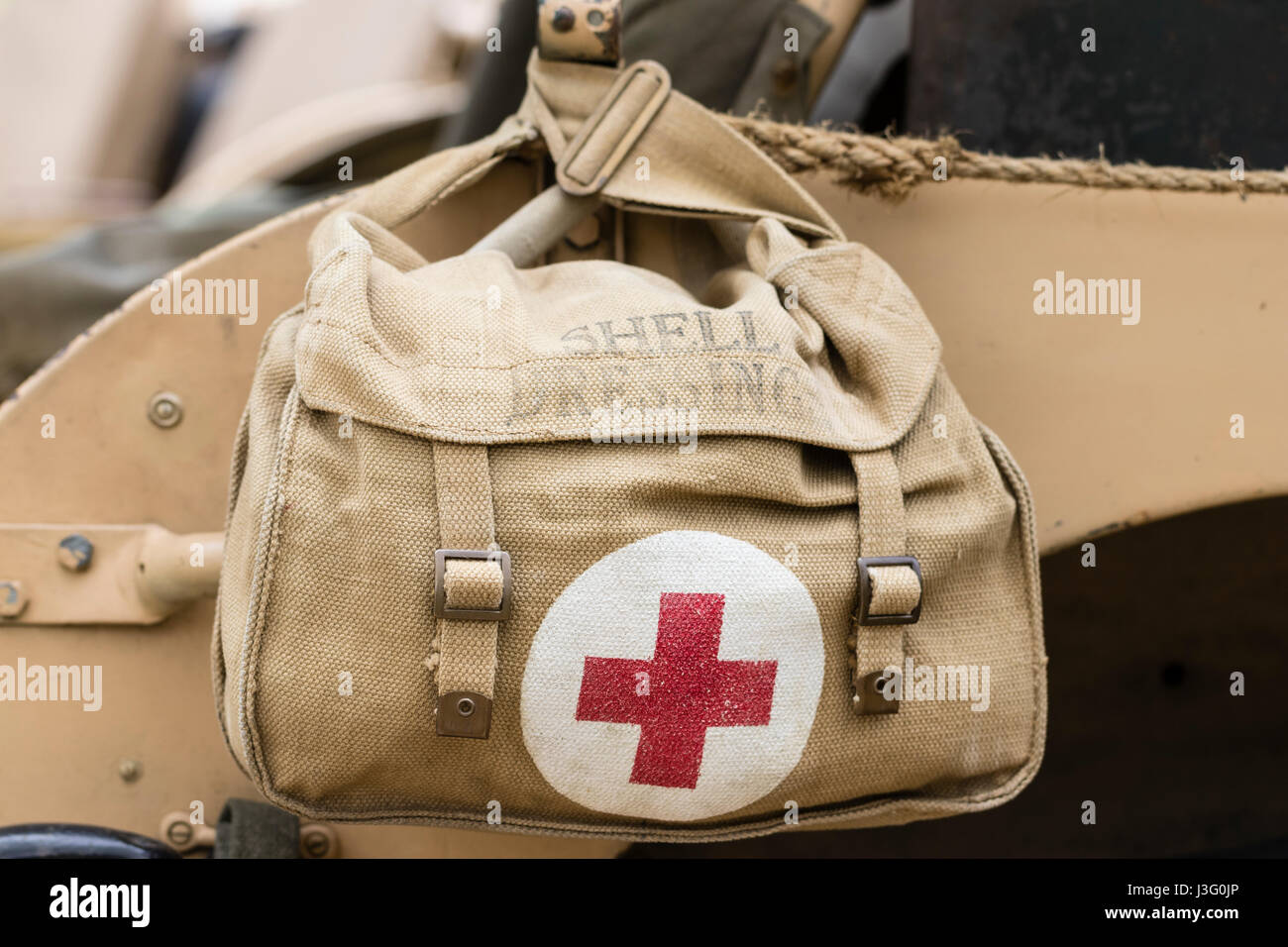 World war two red cross British army, Desert Rats, khaki medical bag.Red cross logo in red on white circle on bag, - Stock Image