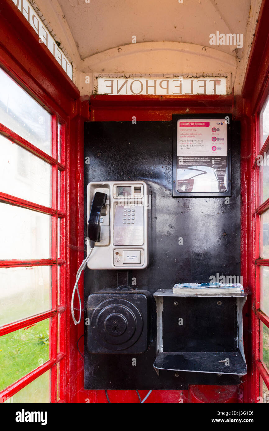 Red telephone box interior - Scottish Highlands, UK - Stock Image