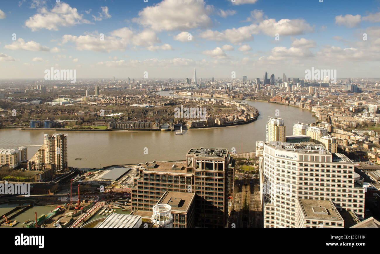 Sun shining on East London and The City from 1 Canada Square in the Canary Wharf Docklands development. - Stock Image