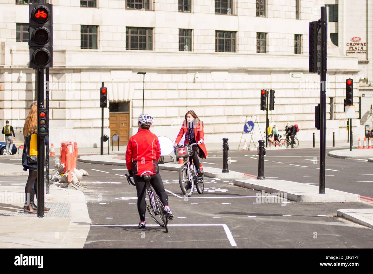 London, England - April 30, 2016: Cyclists using the newly completed segregated North-south Cycle Superhighway, CS6, at Blackfriars Bridge. Stock Photo