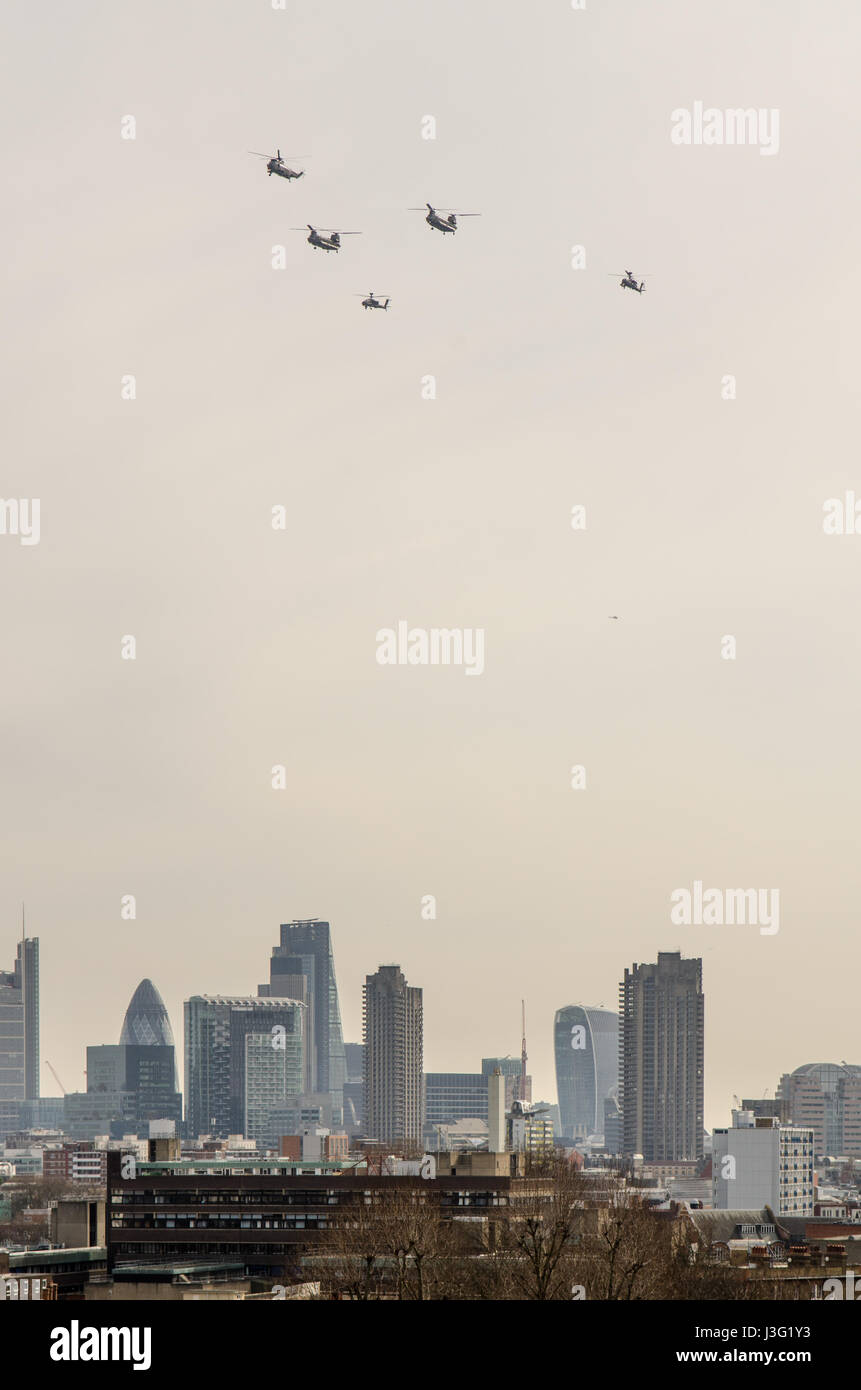 London, England, UK - March 13, 2015: Military Chinook helicopters race over the City of London as part of a commemorative - Stock Image