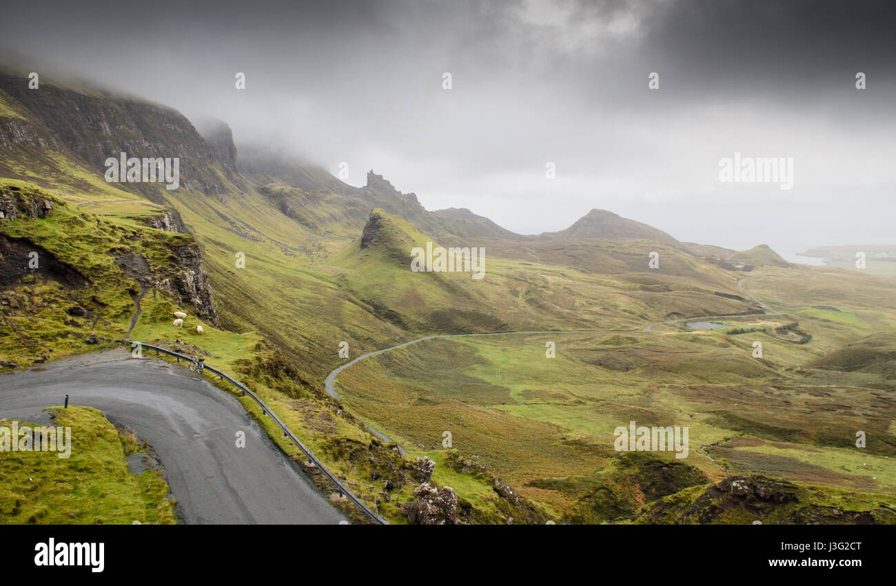 Rain clouds roll across the fairytale landscape of the Quiraing, formed from mountain landslips, on the Trotternish - Stock Image