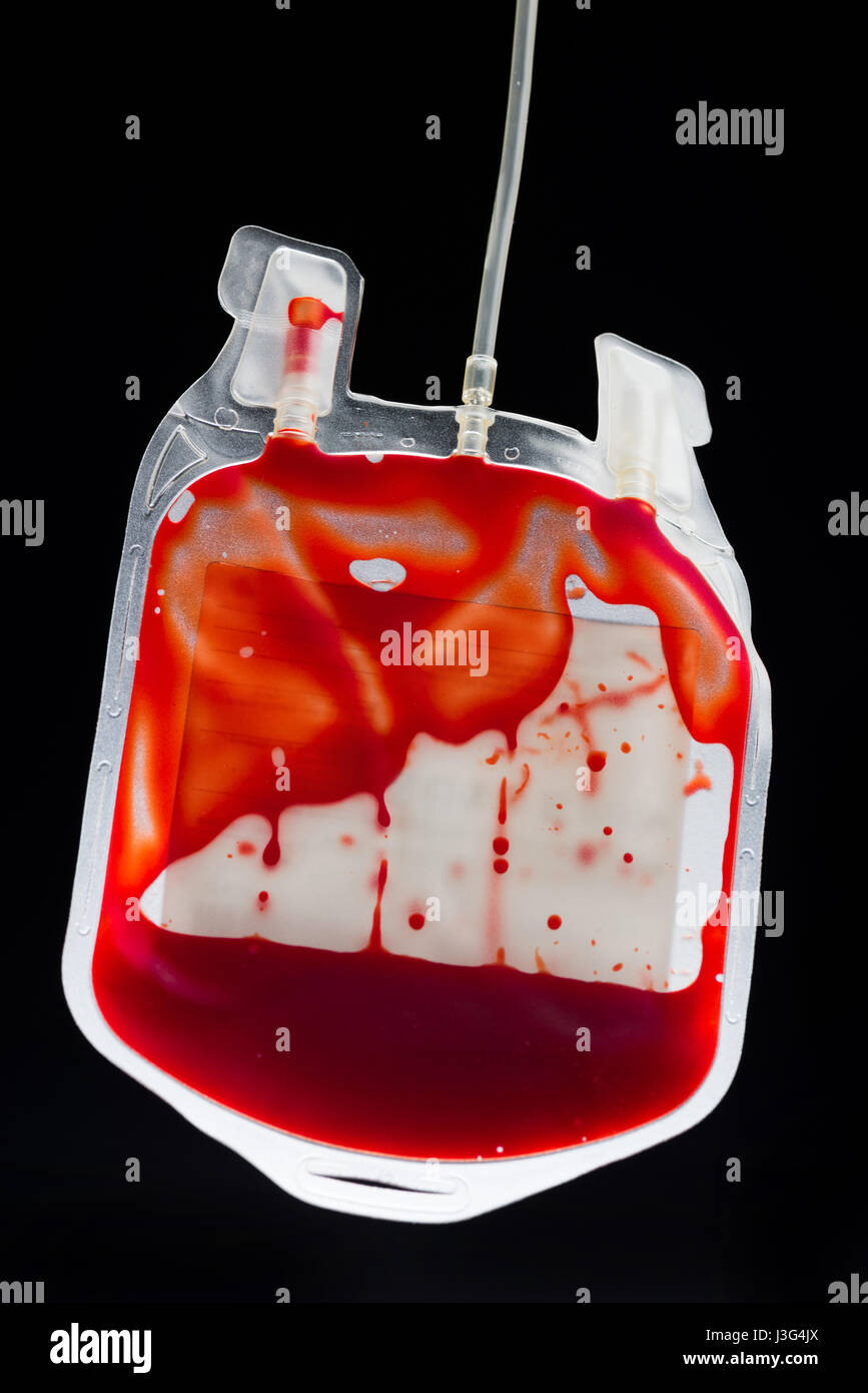 Close-up view of donate blood in bag on black, donation concept - Stock Image