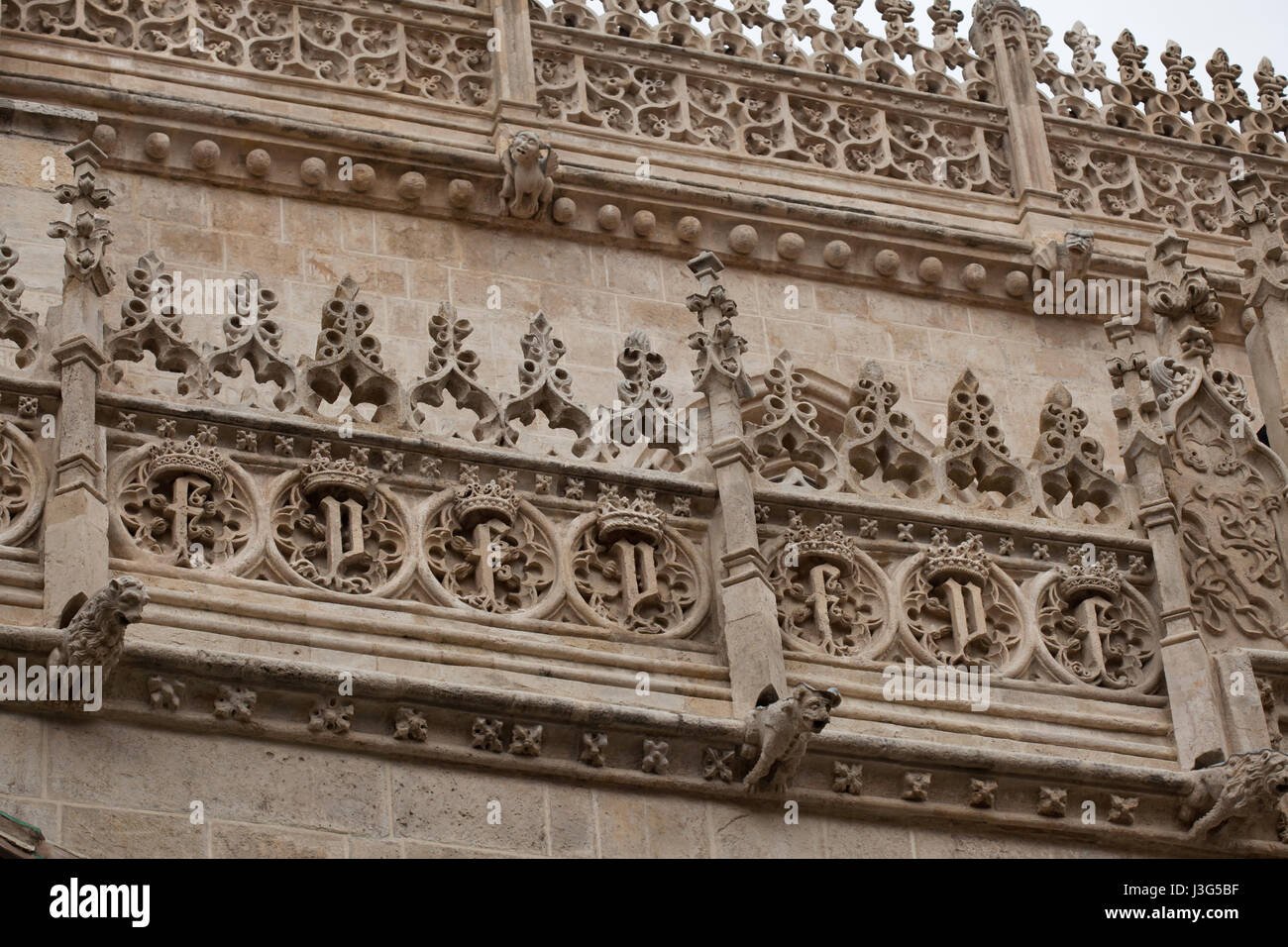 Royal monograms of Queen Isabella I of Castile and King Ferdinand II of Aragon depicted on the facade of the Royal - Stock Image