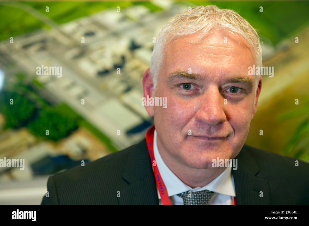 Nigel Cann, Hinkley C Construction Director in front of an artist impression of the proposed Hinkley Point C nuclear - Stock Image