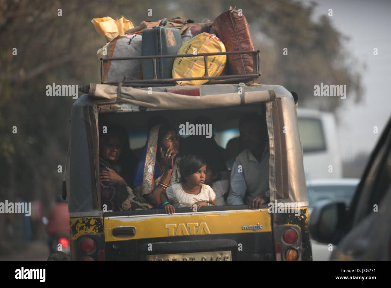 Crowded motor rikshaw on an Indian highway Stock Photo