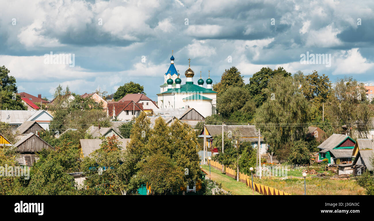 Mir, Belarus. Panoramic Landscape Of Village Houses And Orthodox Church Of The Holy Trinity In Mir, Belarus. Famous - Stock Image
