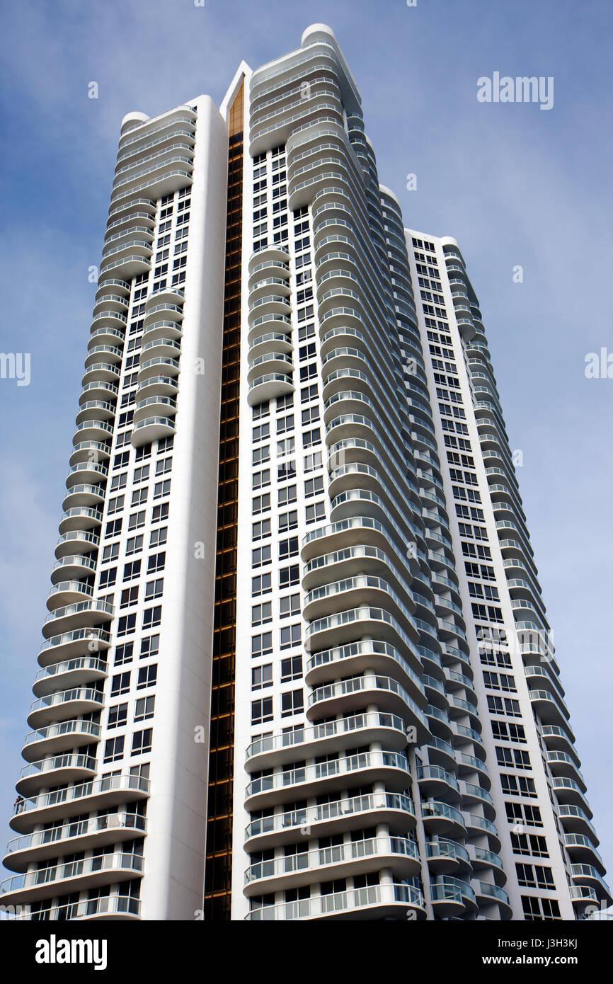 Miami Beach Florida North Beach Collins Avenue high rise condominium condo building multi-family balconies glass - Stock Image
