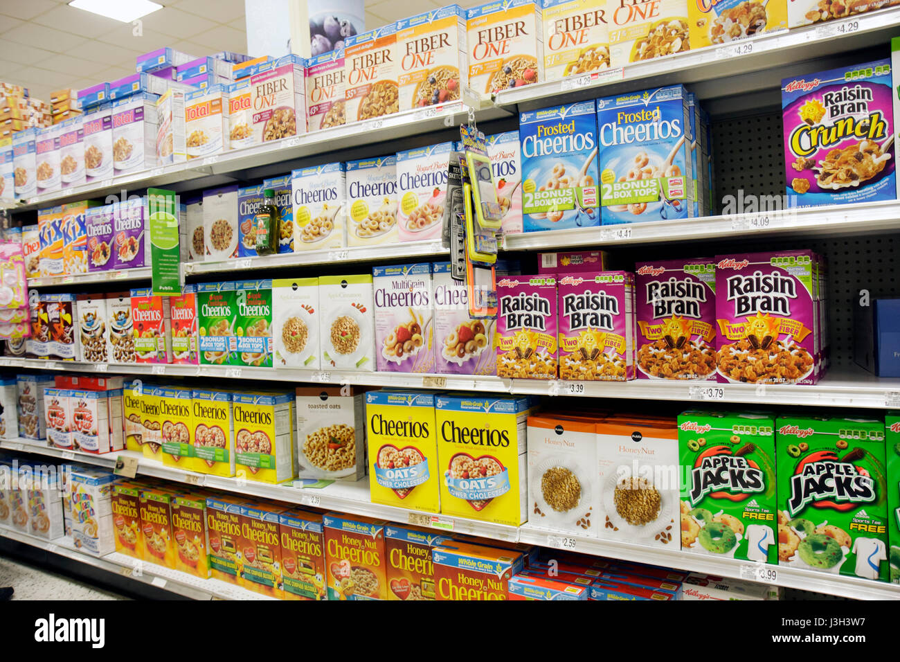 Miami Beach Florida Publix Grocery Store shelves display packaging food variety cereal grains Kellogg's Post - Stock Image