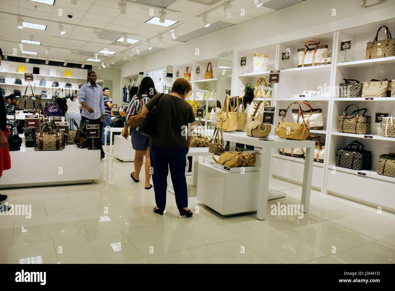 446d47548e0f Miami Florida Dolphin Mall Michael Kors outlet store Black man woman women  shoppers shopping clerk sale designer handbags leathe