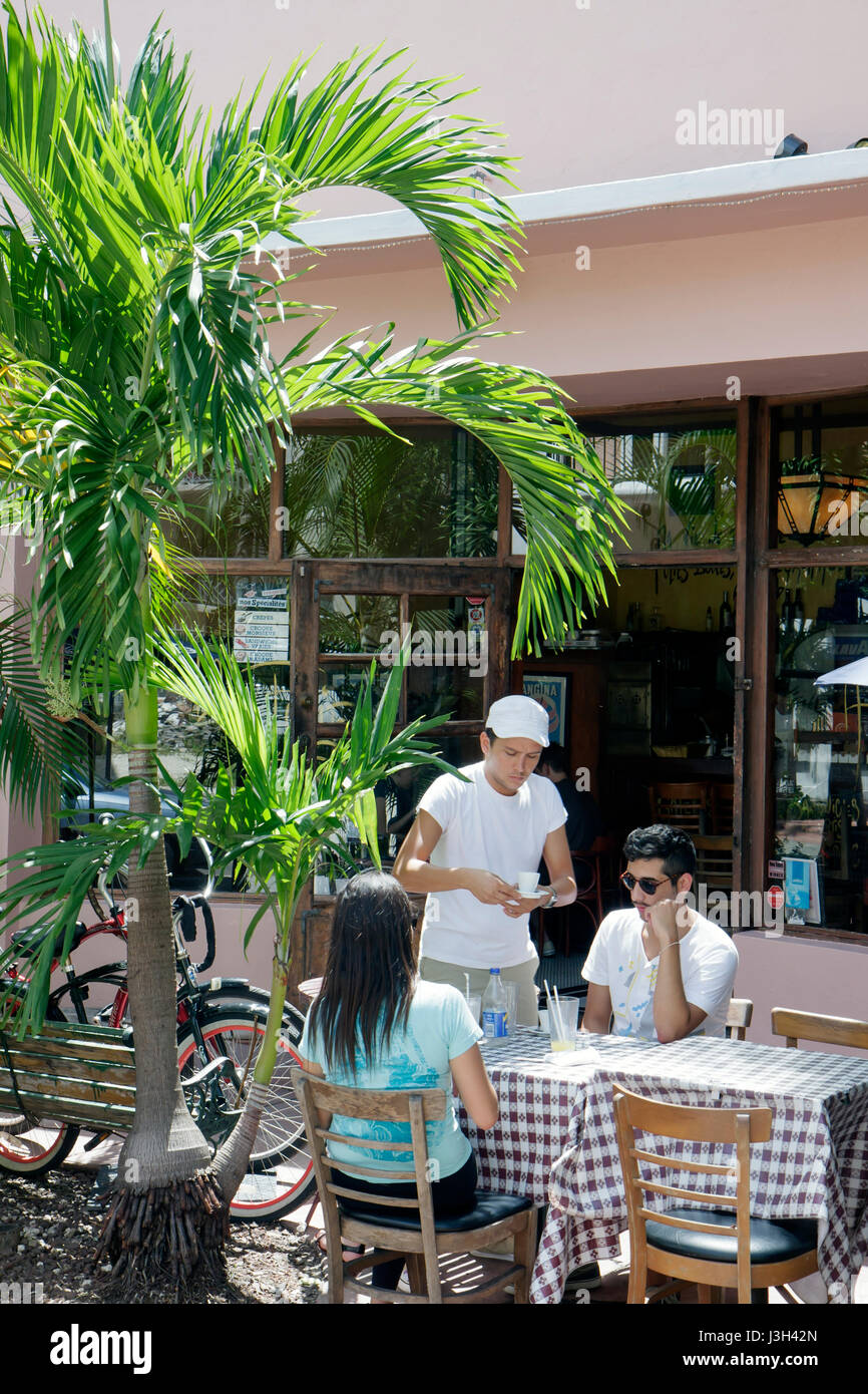 Miami Beach Florida Espanola Way A La Folie Cafe Francais French restaurant sidewalk cafe table man men woman couple - Stock Image