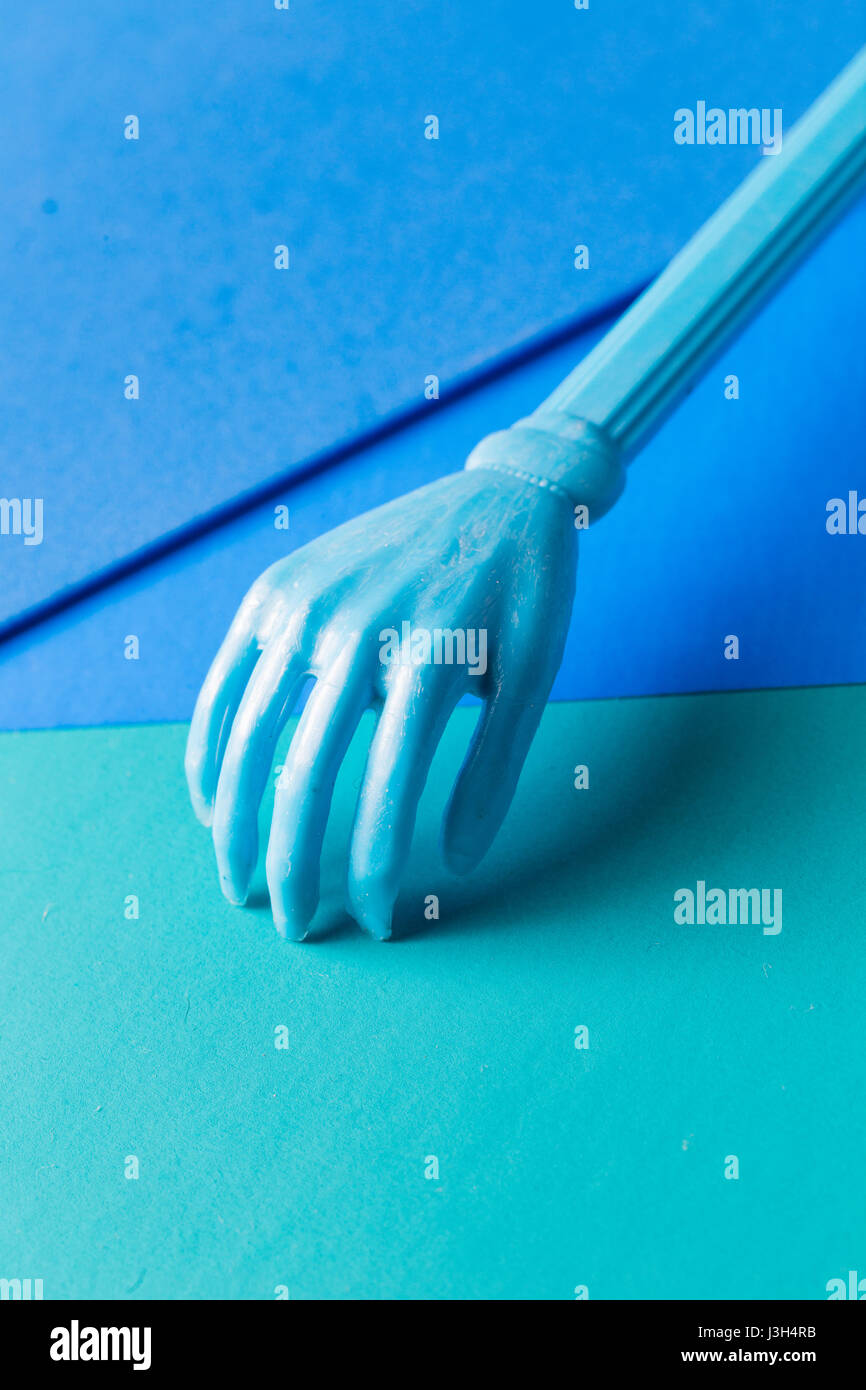 Her Life in Shades of Blue: Still Life of a plastic mini hand placed in a multi-tone shades of blue. - Stock Image