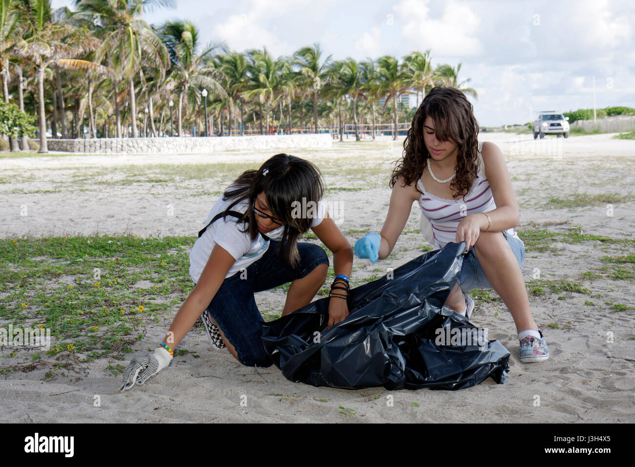 Miami Beach Florida Lummus Park International Coastal Cleanup volunteers students girls teenagers teens environment - Stock Image