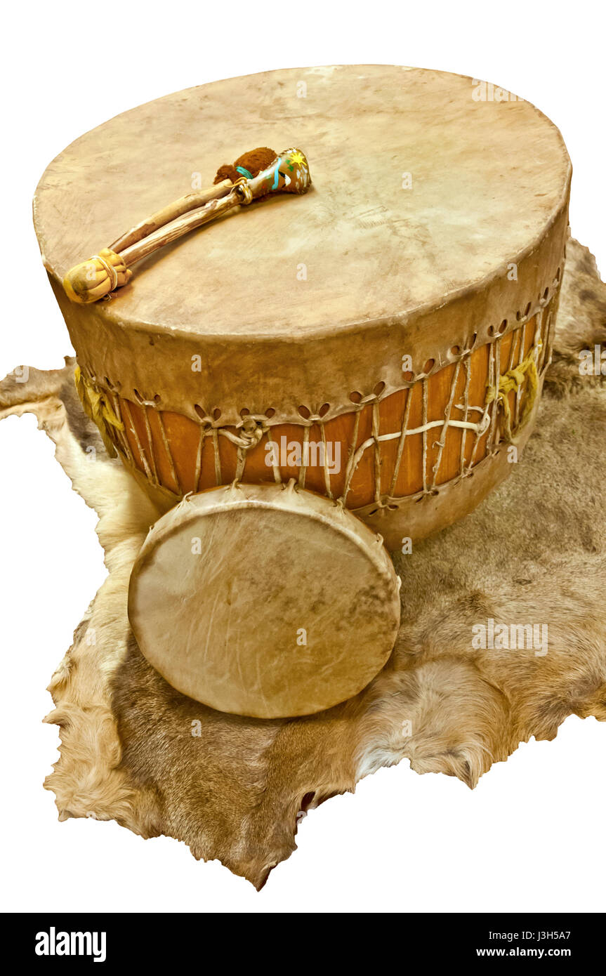 Native American floor and hand drum with beaters on deer animal skin - Stock Image